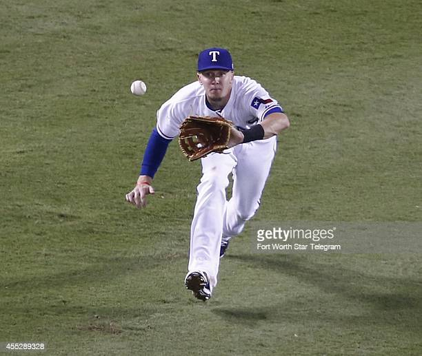 Texas Rangers left fielder Ryan Rua reaches out and catches a fly hit by the Los Angeles Angels' Erick Aybar during the sixth inning on Thursday,...