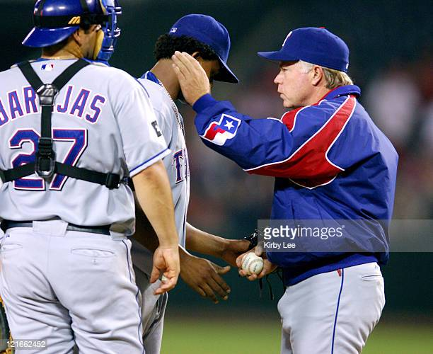 Texas Rangers manager Buck Showalter removes reliever Edison Volquez as catcher Rod Barajas watches in the sixth inning of 74 loss to the Los Angeles...