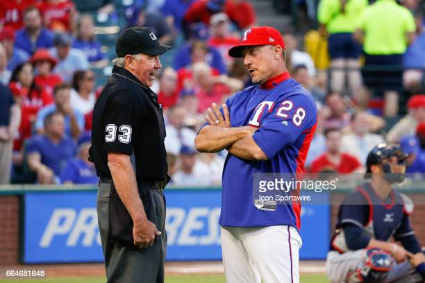 Texas Rangers Manager Jeff Banister discusses a call with Home Plate Umpire Mike Winters during the MLB opening day baseball game between the Texas...