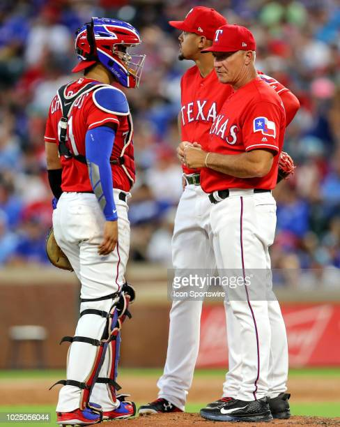 Texas Rangers manager Jeff Banister goes to the mound to get a relieve pitcher during the game between the Los Angeles Dodgers and Texas Rangers on...