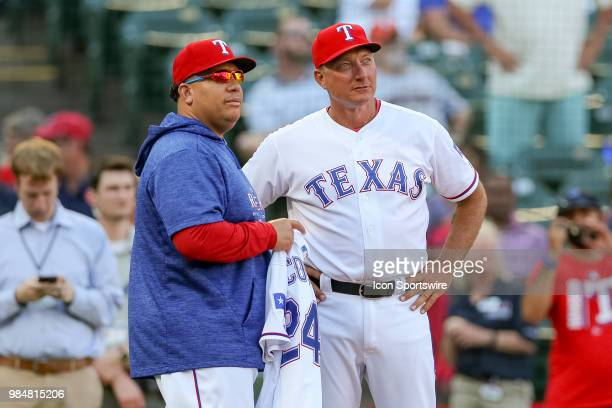 Texas Rangers Manager Jeff Bannister presents a jersey to Pitcher Bartolo Colon for becoming the alltime winning Dominican pitcher prior to the game...