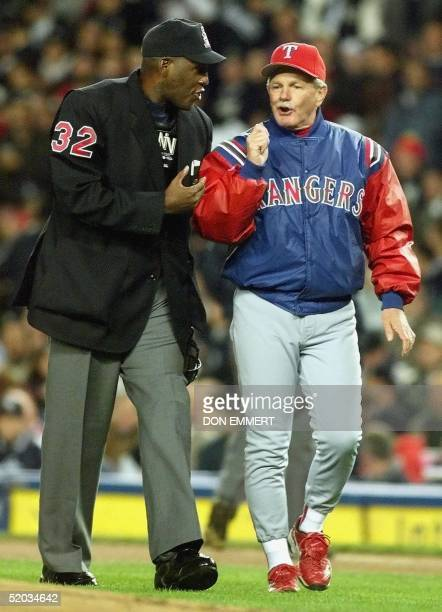 Texas Rangers manager Johnny Oates argues with home plate umpire Chuck Meriwether after Ivan Rodriguez was not allowed to advance to second base on...