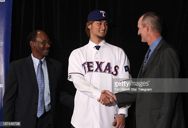 Texas Rangers manager Ron Washington, left, looks on as new Rangers pitcher Yu Darvish, center, shakes hands with pitching coach Mike Maddux during a...