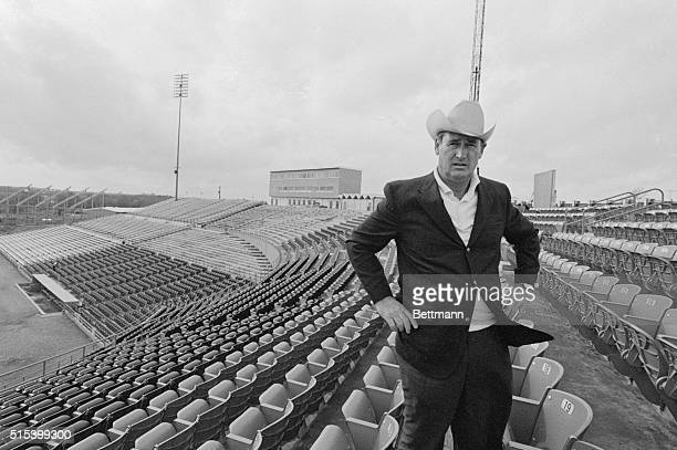 Texas Rangers' Manager Ted Williams walks through a gusty wind here as he surveys Turnpike Stadium in the Dallas suburb of Arlington the new home of...