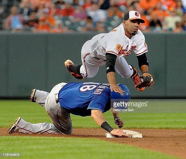 Texas Rangers' Mitch Moreland is forced out at 2nd base as Baltimore Orioles' Alexi Casilla turns a double play during the 4th inning at Oriole Park...