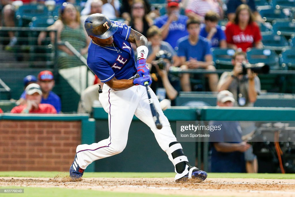 Texas Rangers Outfield Delino DeShields (3) hits a triple off of the outfield wall during the MLB game between the Miami Marlins and Texas Rangers on July 24, 2017 at Globe Life Park in Arlington, TX. Miami defeats Texas 4-0.