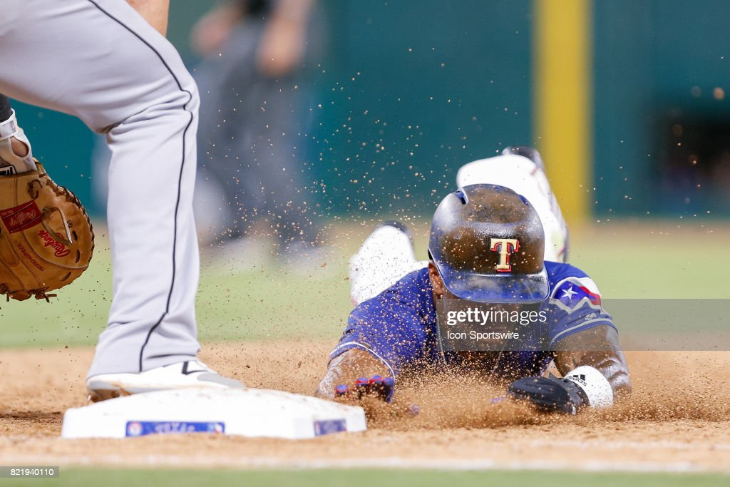 Texas Rangers Outfield Delino DeShields (3) slides back to first avoiding being doubled off during the MLB game between the Miami Marlins and Texas Rangers on July 24, 2017 at Globe Life Park in Arlington, TX. Miami defeats Texas 4-0.