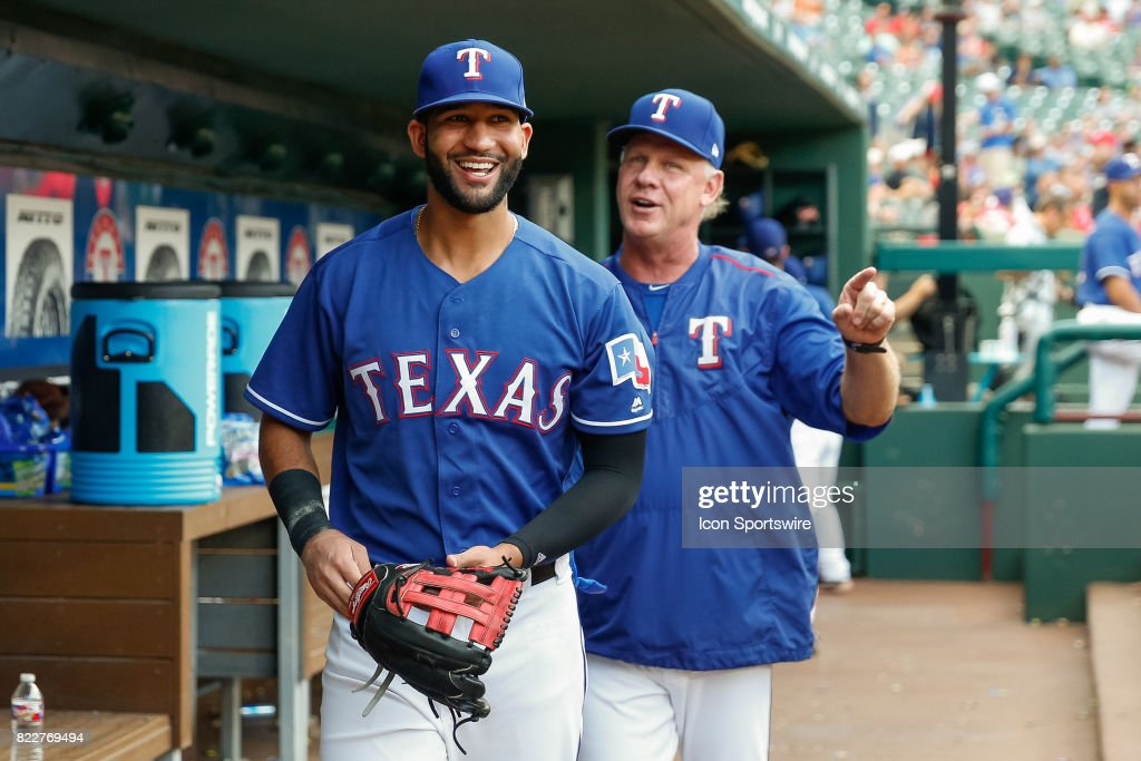 Texas Rangers Outfield Nomar Mazara (30) and bench coach Steve Buechele (24) joke around prior to the MLB game between the Miami Marlins and Texas Rangers on July 24, 2017 at Globe Life Park in Arlington, TX.