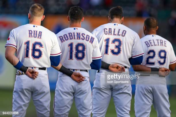 Texas Rangers Outfielders Ryan Rua and Drew Robinson First base Joey Gallo and Third base Adrian Beltre stand for the National Anthem prior to the...