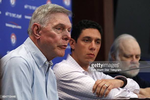 Texas Rangers owners Ray Davis left and Bob Simpson right flank President of Baseball Operations and General Manager Jon Daniels at a news conference...