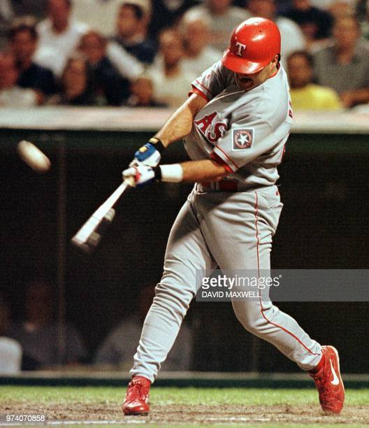 Texas Rangers pinch hitter Rafael Palmeiro hits a three run home run off of Cleveland Indians relief pitcher Steve Reed in the seventh inning on 16...