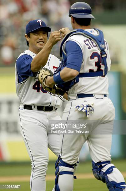 Texas Rangers pitcher Akinori Otsuka celebrates with catcher Chris Stewart right after closing out the game against the Toronto Blue Jays at Rangers...