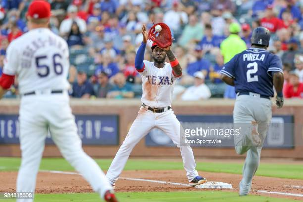 Texas Rangers Pitcher Austin BibensDirkx throws over to Texas Rangers Infield Jurickson Profar on a ground ball by San Diego Padres Infield Jose...