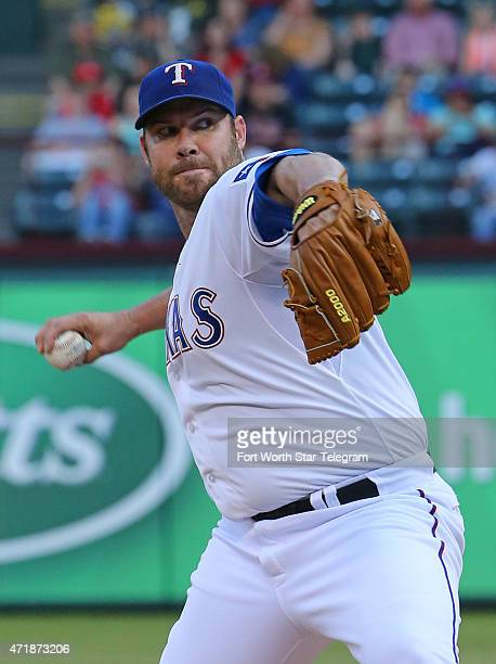 Texas Rangers pitcher Colby Lewis works in the first inning against the Oakland Athletics at Globe Life Park in Arlington Texas on Friday May 1 2015