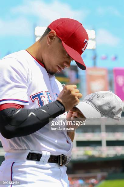 Texas Rangers Pitcher Keone Kela signs autographs prior to the baseball game between the Houston Astros and Texas Rangers on March 31 2018 at Globe...