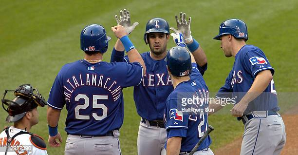 Texas Rangers' Ramon Vazquez is congratulated after his threerun home run in the fourth inning against the Baltimore Orioles during game one of a...