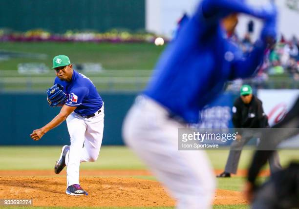 Texas Rangers relief pitcher Yohander Mendez pitches during the MLB Spring Training baseball game between the Kansas City Royals and the Texas...