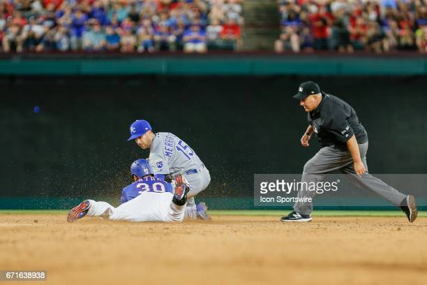 Texas Rangers Right field Nomar Mazara slides in ahead of the tag by Kansas City Royals Outfield Whit Merrifield during the MLB game between the...