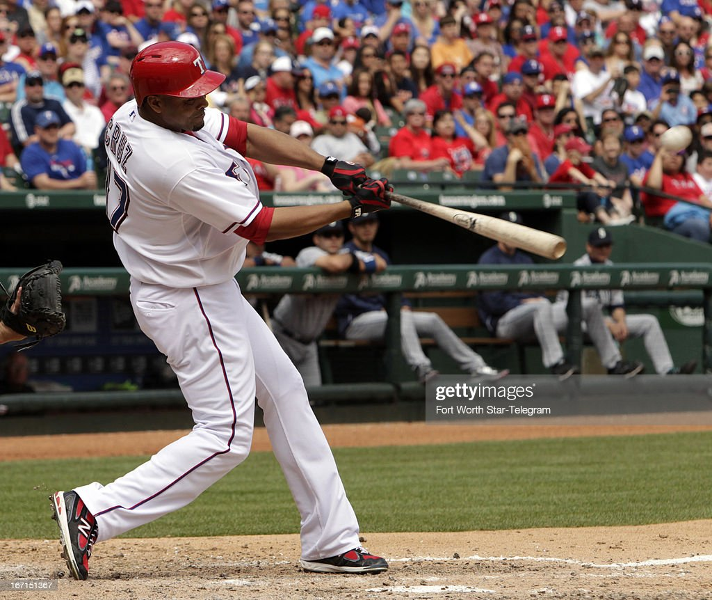 Texas Rangers right fielder Nelson Cruz (17) connects for a grand slam home run in the bottom of the fifth inning against the Seattle Mariners in Arlington, Texas, on Sunday, April 21, 2013. Berkman scored on the play.
