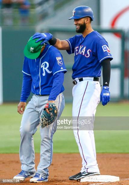 Texas Rangers right fielder Nomar Mazara and Kansas City Royals infielder Cheslor Cuthbert share a laugh during the MLB Spring Training baseball game...