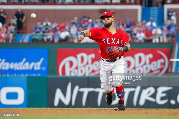 Texas Rangers Second base Rougned Odor fields a ground ball during the MLB opening day baseball game between the Texas Rangers and Cleveland Indians...