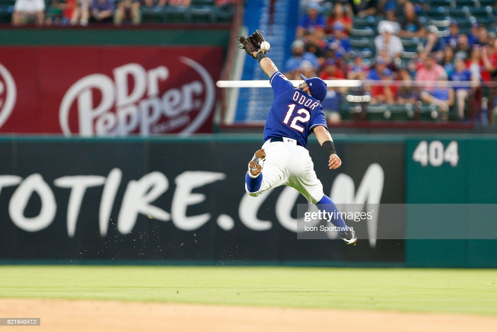 Texas Rangers Second base Rougned Odor (12) leaps for a ball during the MLB game between the Miami Marlins and Texas Rangers on July 24, 2017 at Globe Life Park in Arlington, TX. Miami defeats Texas 4-0.