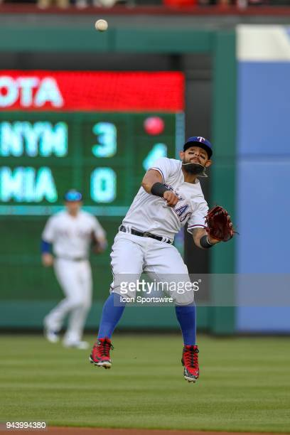 Texas Rangers Second base Rougned Odor makes a barehanded play on a ground ball and attempts to make the throw to first base during the game between...