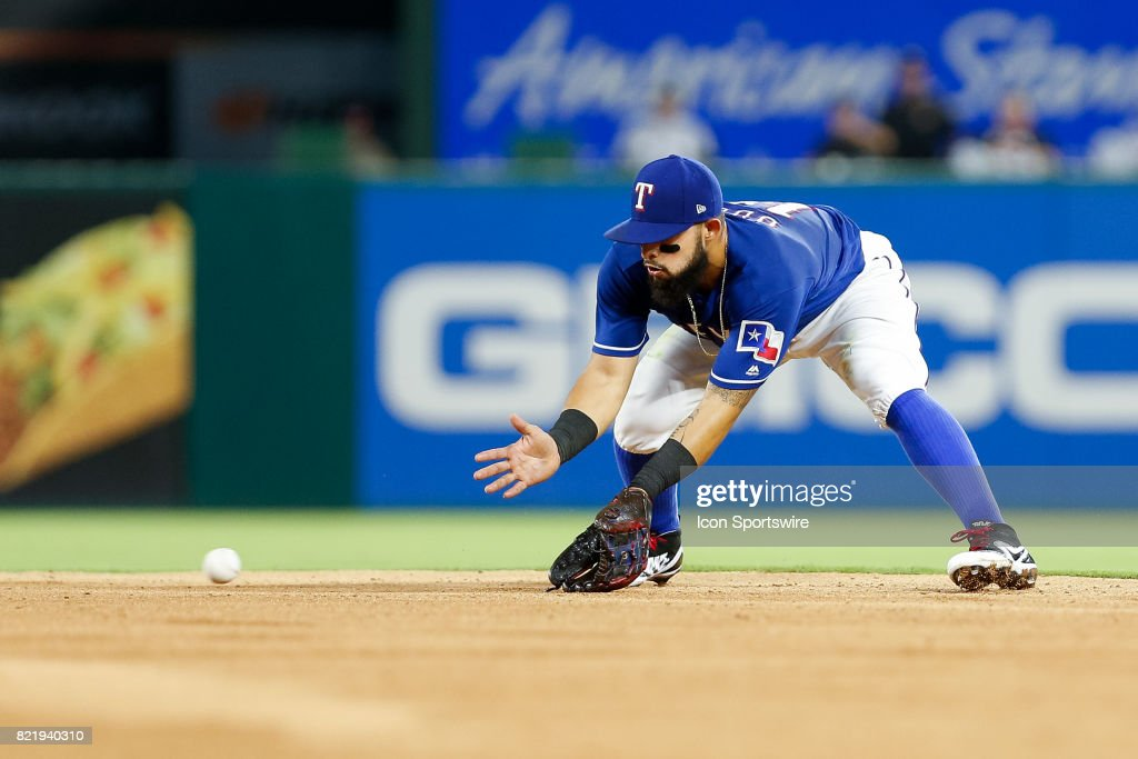 Texas Rangers Second base Rougned Odor (12) plays a ground ball during the MLB game between the Miami Marlins and Texas Rangers on July 24, 2017 at Globe Life Park in Arlington, TX. Miami defeats Texas 4-0.