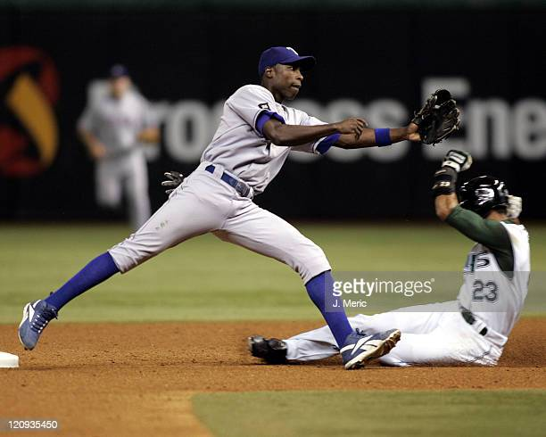 Texas Rangers second baseman Alfonso Soriano prepares to take the throw at second as Tampa Bay's Julio Lugo slides under and safely into second in...