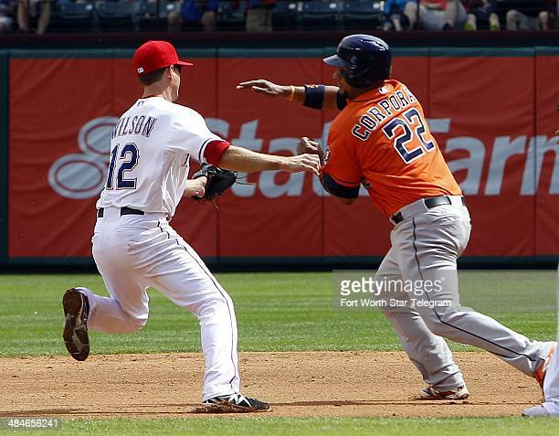 Texas Rangers second baseman Josh Wilson goes to tag Houston Astros catcher Carlos Corporan during a rundown in the sixth inning at Globe Life Park...