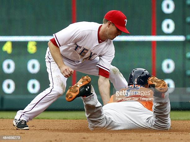 Texas Rangers second baseman Josh Wilson makes the tag on the Houston Astros' Jonathan Villar in the third inning at Globe Life Park in Arlington...