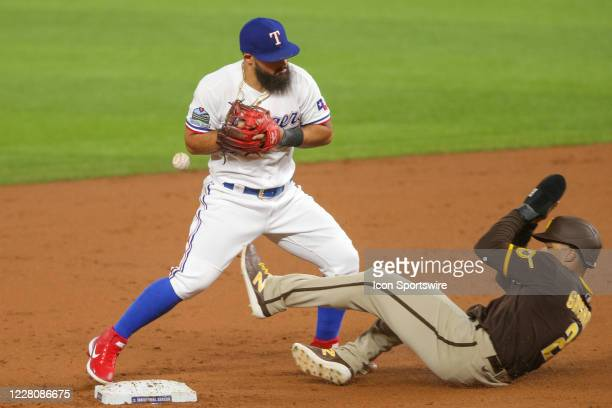 Texas Rangers second baseman Rougned Odor bobbles the ball while trying to turn a double play with San Diego Padres right fielder Trent Grisham...