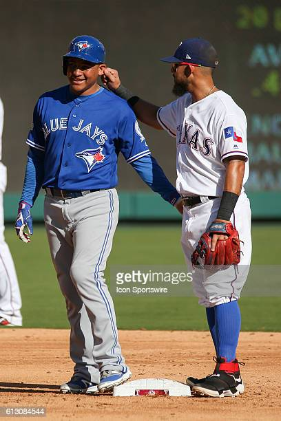 Texas Rangers second baseman Rougned Odor grabs Toronto Blue Jays right fielder Ezequiel Carrera ear after he reaches second base during game 1 of...