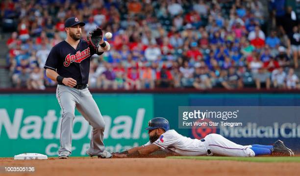 Texas Rangers second baseman Rougned Odor steals second base as Cleveland Indians second baseman Jason Kipnis fields the throw from the catcher in...