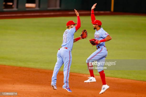 Texas Rangers shortstop Anderson Tejeda and center fielder Leody Taveras high five after winning the game between the Texas Rangers and the Oakland...