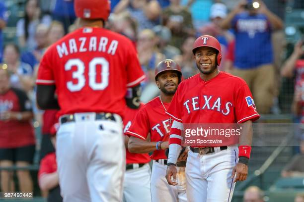 Texas Rangers Shortstop Elvis Andrus and Center field Delino DeShields wait for Right fielder Nomar Mazara to cross the plate after he hits a 3 run...