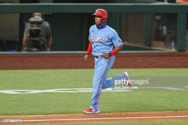 Texas Rangers shortstop Elvis Andrus jogs home for a run during the MLB game between the Los Angeles Angels and Texas Rangers on August 9, 2020 at...