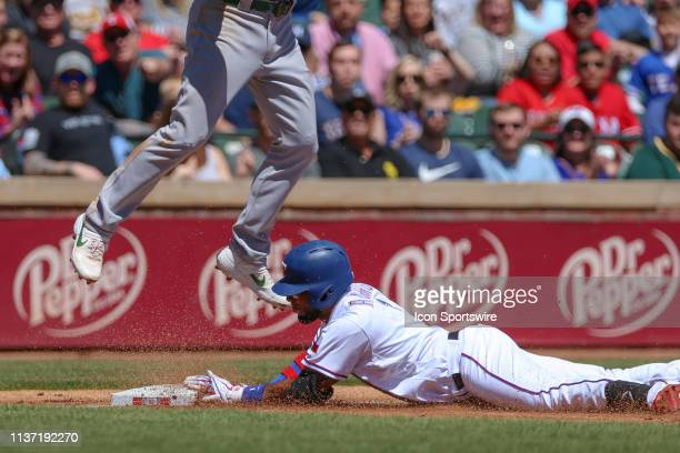 Texas Rangers shortstop Elvis Andrus slides into third base after hitting a triple during the game between the Oakland Athletics and Texas Rangers on...