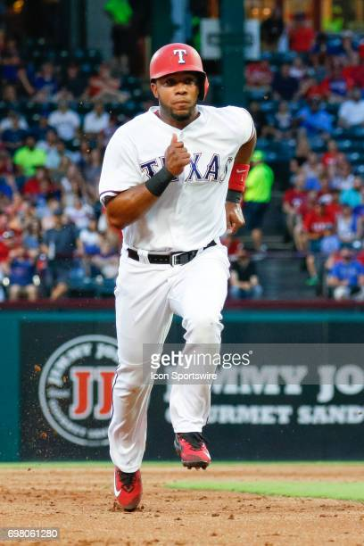 Texas Rangers shortstop Elvis Andrus tags up and heads to third base during the MLB game between the Toronto Blue Jays and Texas Rangers on June 19...