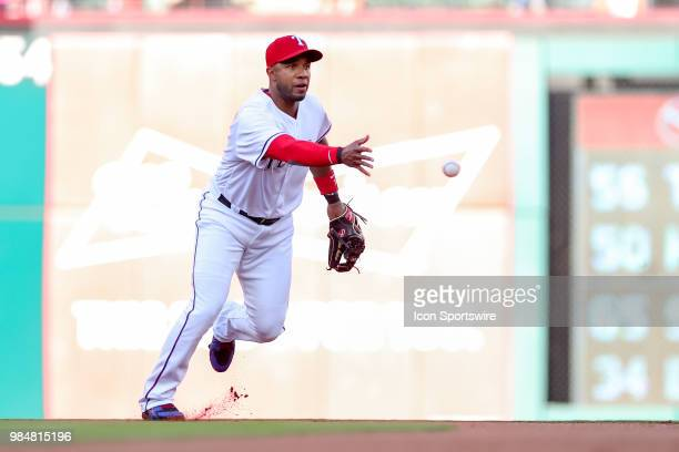 Texas Rangers Shortstop Elvis Andrus tosses a ball to begin a double play during the game between the San Diego Padres and Texas Rangers on June 26...