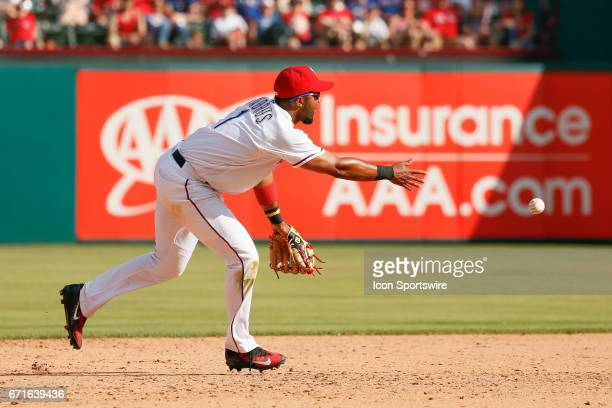 Texas Rangers Shortstop Elvis Andrus tosses to second base during the MLB baseball game between the Oakland Athletics and Texas Rangers on April 9...