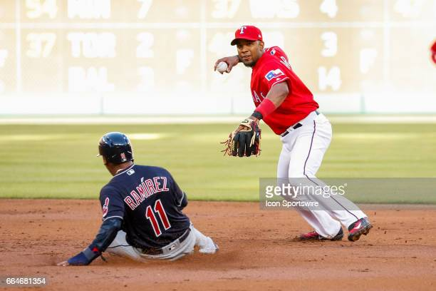 Texas Rangers Shortstop Elvis Andrus turns a double play during the MLB opening day baseball game between the Texas Rangers and Cleveland Indians on...