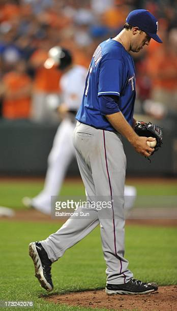 Texas Rangers starter Josh Lindblom reacts to a 3run homer by Baltimore Orioles' Nolan Reimold during the 4th inning at Oriole Park at Camden Yards...