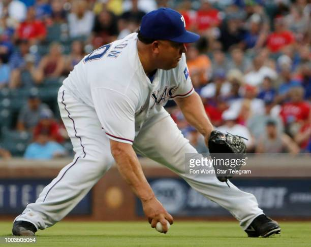 Texas Rangers starting pitcher Bartolo Colon scrambles to field a hit by Cleveland Indians center fielder Tyler Naquin Colon making the throw to...