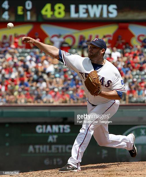 Texas Rangers starting pitcher Colby Lewis works against the Colorado Rockies at Rangers Ballpark in Arlington Texas Saturday June 23 2012 The...
