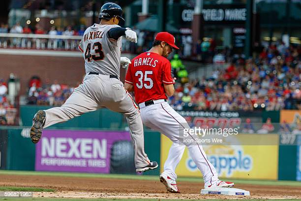Texas Rangers Starting pitcher Cole Hamels [3149] tags 1st base just ahead of San Francisco Giants Outfield Justin Maxwell [6048] during the MLB...