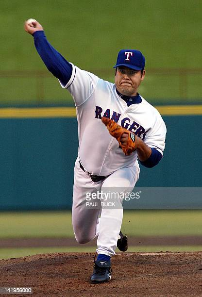 Texas Rangers' starting pitcher Hideki Irabu delivers a pitch in early action against the Seattle Mariners at the Ballpark in Arlington in Arlington...