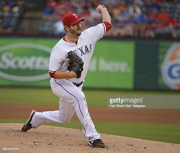 Texas Rangers starting pitcher Joe Saunders works during the first inning as the Detroit Tigers at Globe Life Park in Arlington Texas on Wednesday...