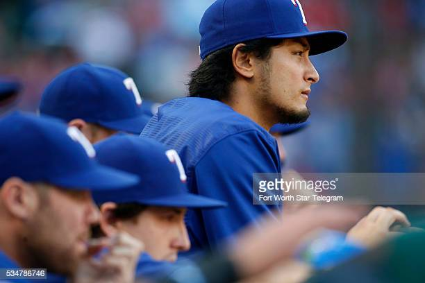 Texas Rangers starting pitcher Yu Darvish, top right, watches from the dugout in the first inning against the Pittsburgh Pirates at Globe Life Park...
