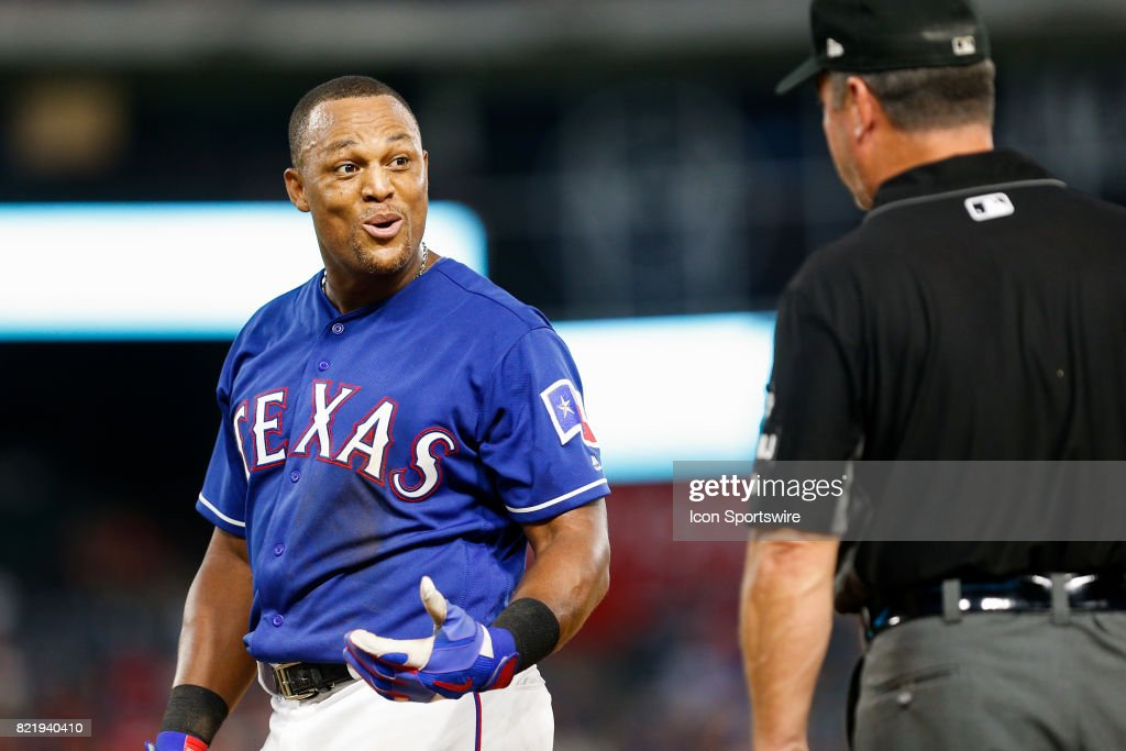 Texas Rangers Third base Adrian Beltre (29) jokes around with first base umpire Rob Drake (30) during the MLB game between the Miami Marlins and Texas Rangers on July 24, 2017 at Globe Life Park in Arlington, TX. Miami defeats Texas 4-0.